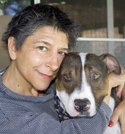 Me sharing a moment of affection with my rescued pit bull mix, Brad Pit. I just purchased Petplan for him (one of the companies we are reviewing) with coverage up to $20,000 per year for a monthly payment of $36. Yes, even vets need pet insurance!