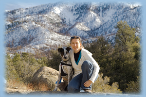 Janet with her dog Cookie, enjoying a hike.