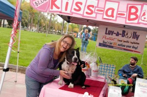 Our bully Zack returned this year to host our Kiss-a-Bull Booth and licked a lot of kissers!